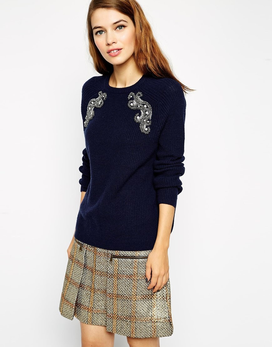 navy jumper with pattern on arms