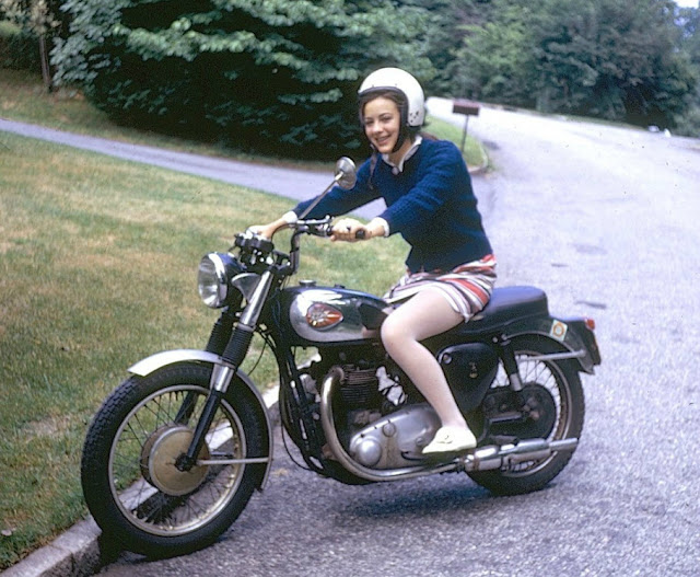 Women riding motorcycles in a mini skirt