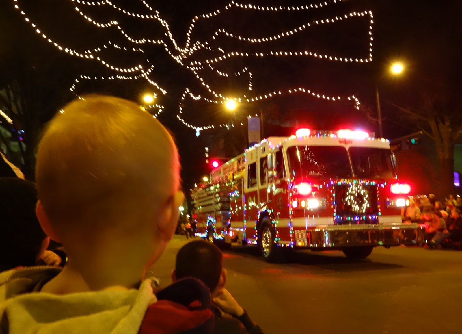 first came this fire engine decked out in full - Greenville Sc Christmas Parade