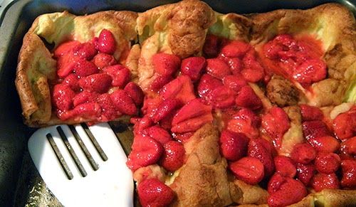 Pan of Popover Pancake with Strawberries Spooned on