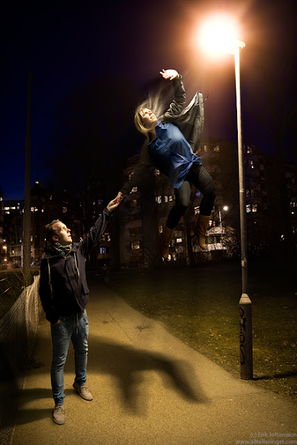 super girl trying to touch street light