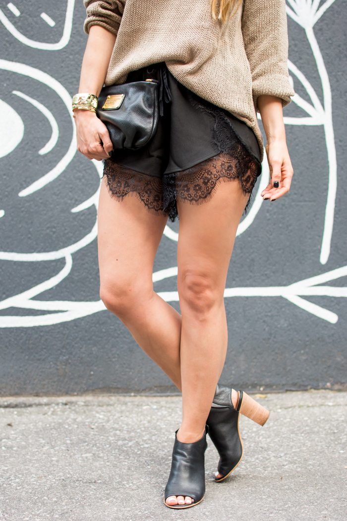 Tailored shorts finished with intricate lace Concealed back zip Lined Rise, about 12