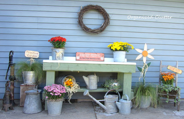 Fall Potting Bench with Mums, Ivies, Ponytail Grass, and Galvanized Cans and Buckets