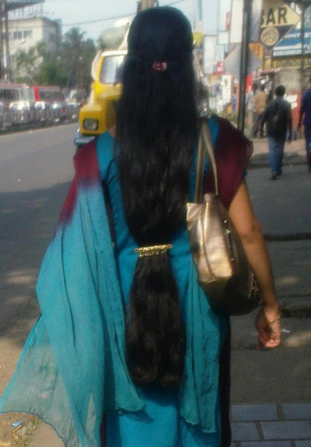 Thick and black long hair clipped at near the butt- a famous kerala hair style.
