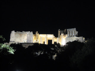The Propylaea entrance of the Acropolis lit up at night.