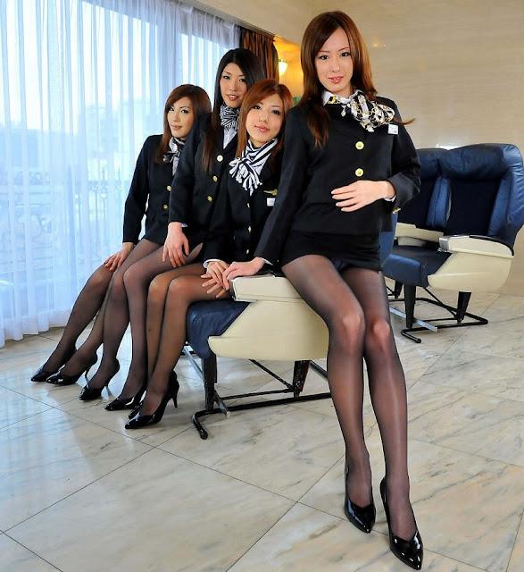 Pretty Japanese Stewardess in Black Suit