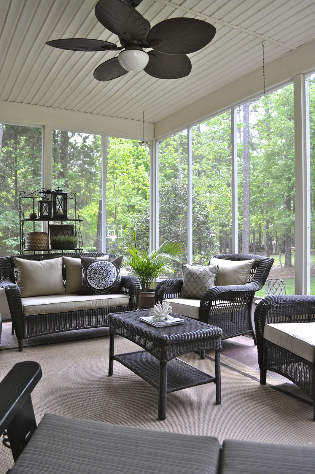 The collected interior a screened porch refresh plans for Screened porch furniture layout