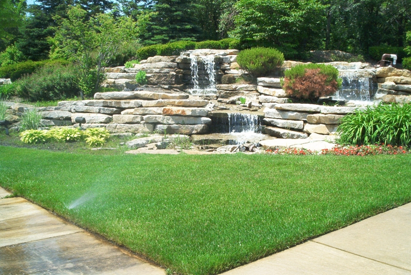 landscaping ideas with waterfall and triangle grass shape best 10 landscaping ideas for your backyard