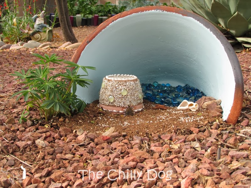 Fairy Garden: Create a fairy house with a clay pot, crushed shells and grout