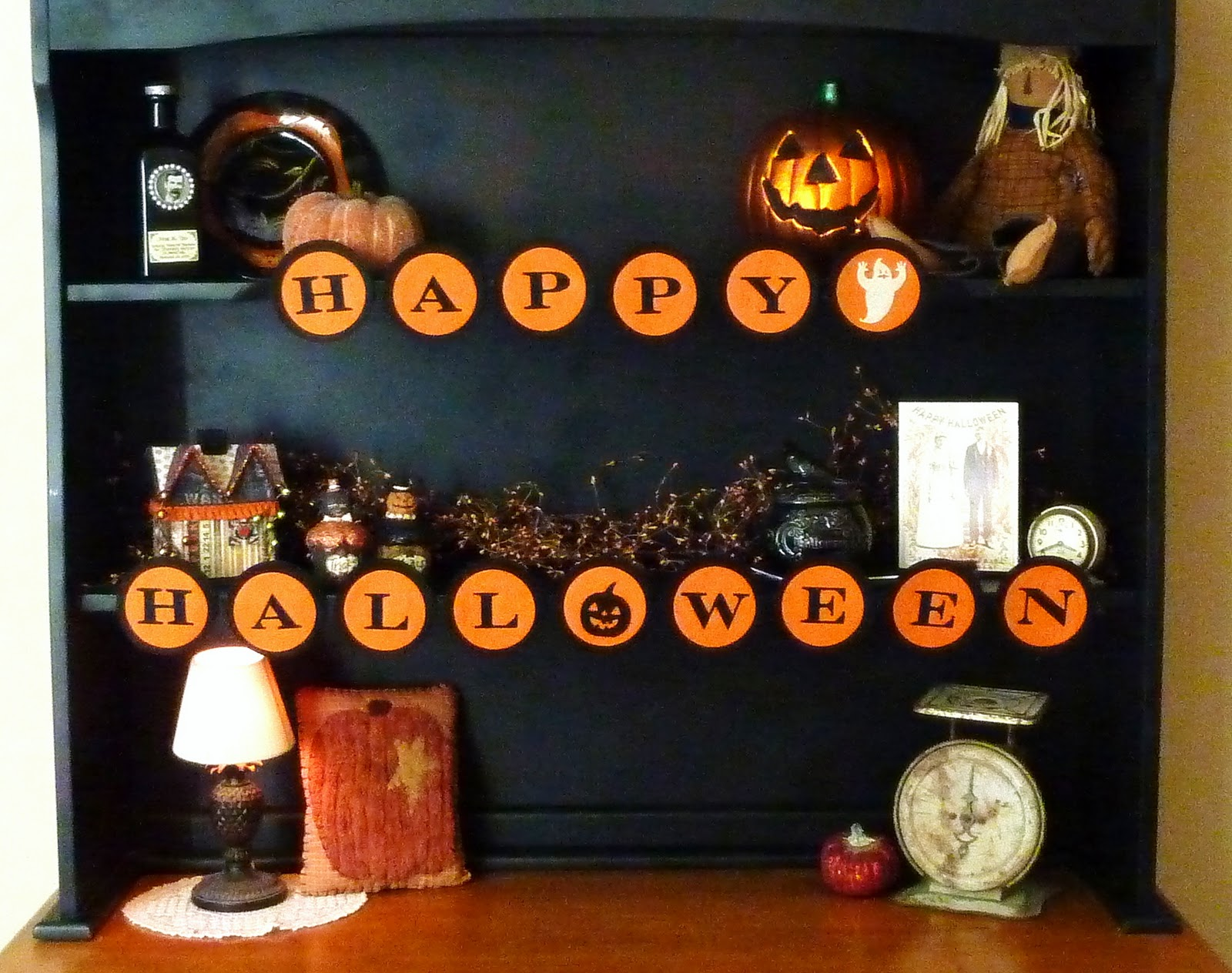 Halloween kitchen decor - This Is The Hutch In Our Breakfast Room Right Next To Where We Eat In The Kitchen I Just Clear It Out Each Season And Fill It Up The Happy Halloween Is