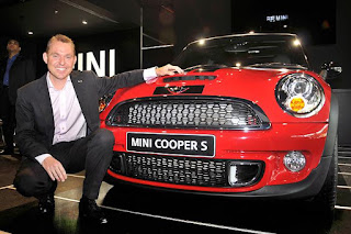 mini cooper s launching in india with model sitting