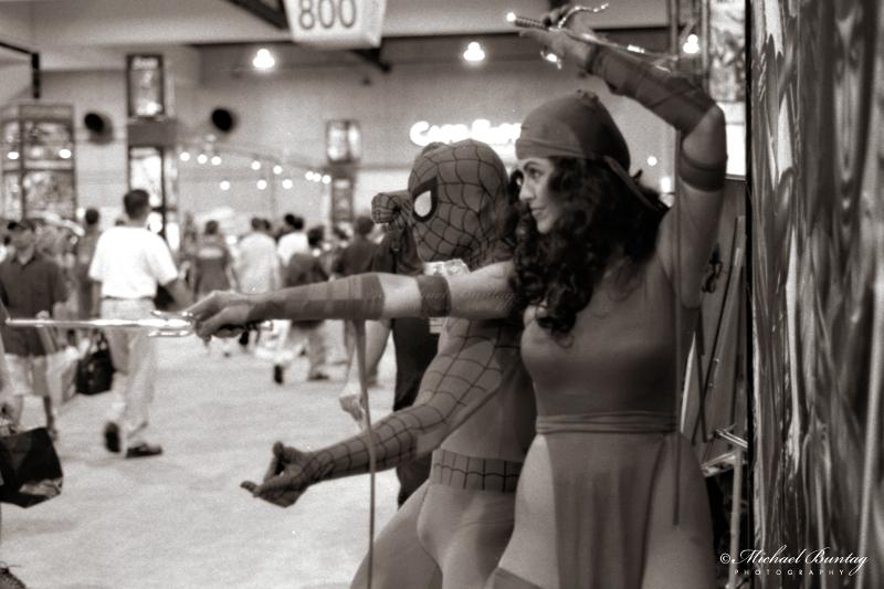 pider-Man, Elektra cosplay, Marvel booth, Comic-Con International, San Diego Convention Center, Marina District, San Diego, California. Ilford HP5+ Black and White 35mm negative film.  © Michael Buntag.