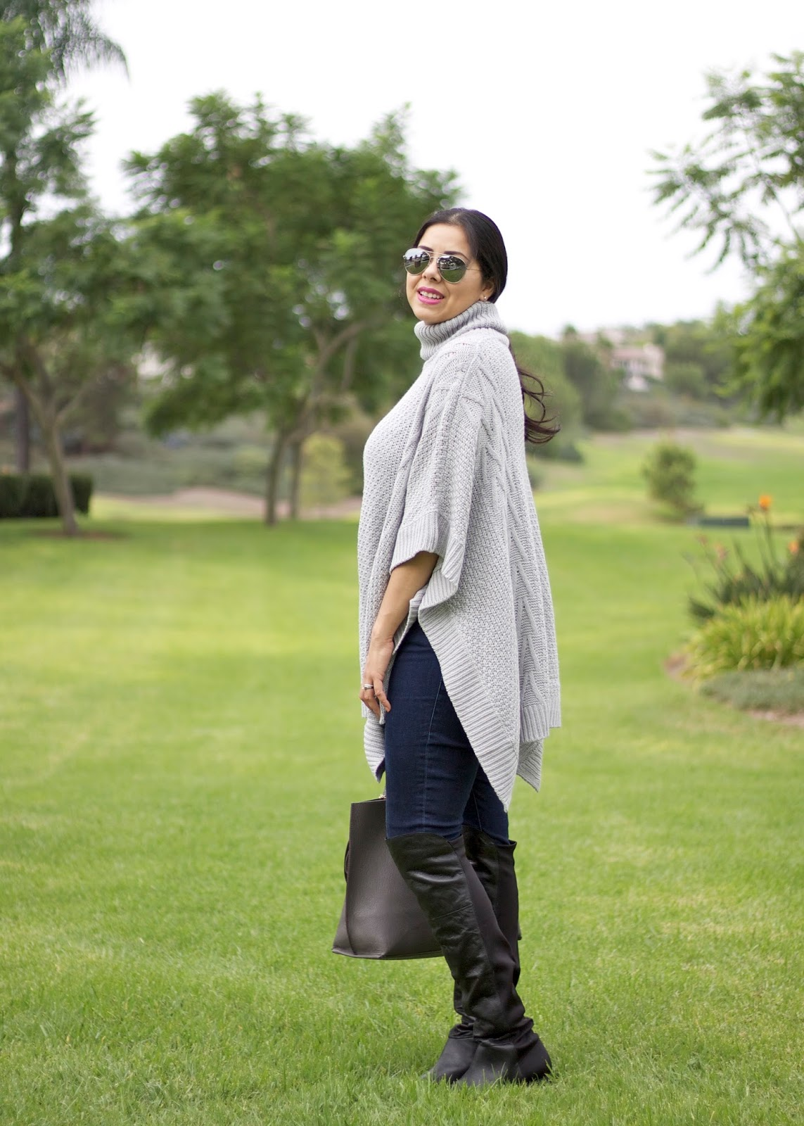 how to wear over the knee boots, poncho and over the knee boots, cabi clothing skinny jeans
