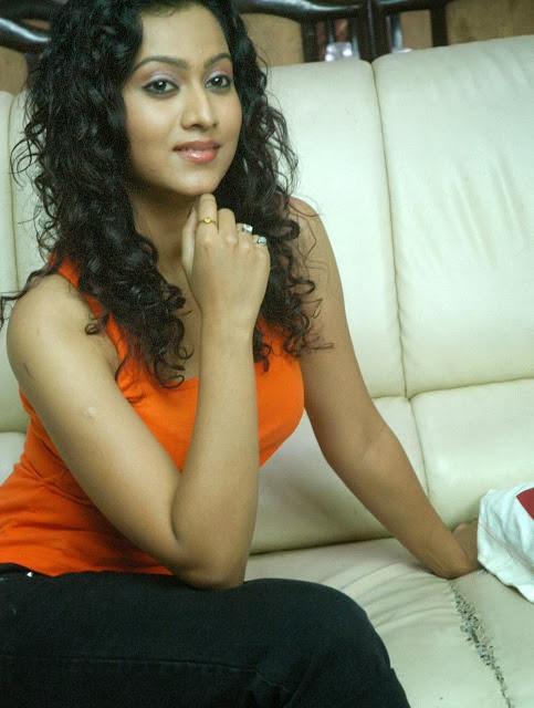Aakarsha In Orange Top
