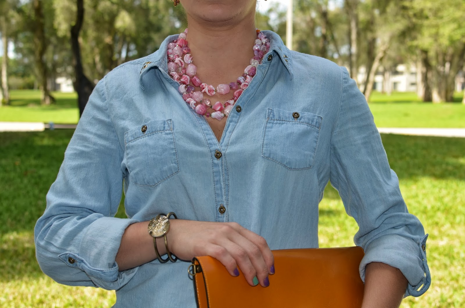 statement necklace - denim top - leather envelope clutch