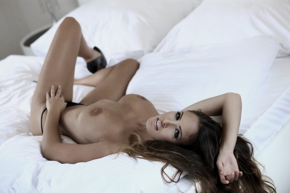 Lucia Javorcekova topless on bed