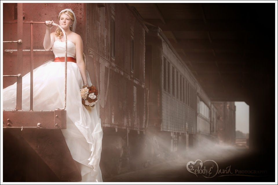 Bride on the back caboose of classic steam engine locomotive.