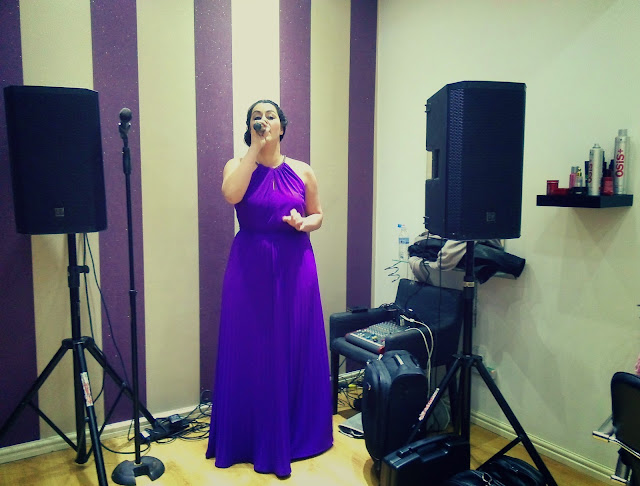Singer in purple dress