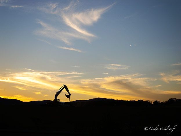 construction scene at sunset