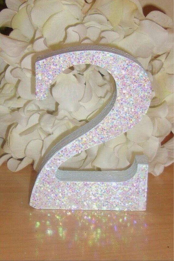 https://www.etsy.com/listing/188266542/self-standing-glitter-table-numbers