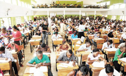 66 yr old & wife arrested by police after caught sitting WAEC exam for their kids!