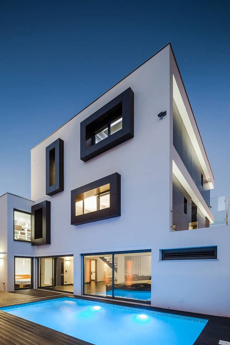 Modern private home with a box body and box windows offers white facade with black framed - The house with protruding windows ...
