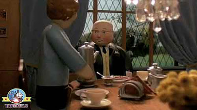 The Fat Controller having a Scottish traditional porridge breakfast eating hot toast and marmalade