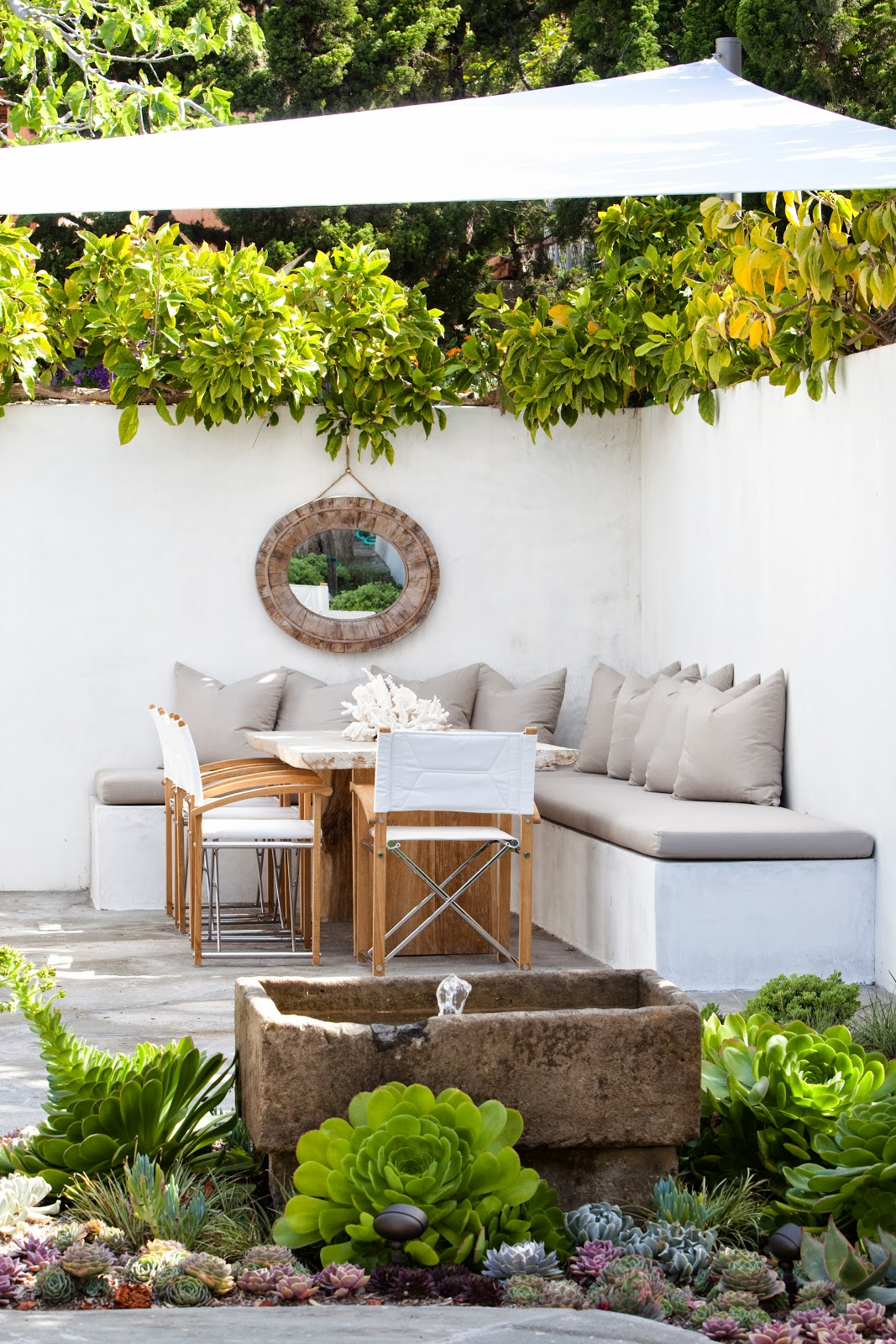 Molly Wood Garden Design we fit this fresh and clean california garden into a narrow l shaped outdoor space the grilling and fountain area are off the kitchen Ciao Fabiana