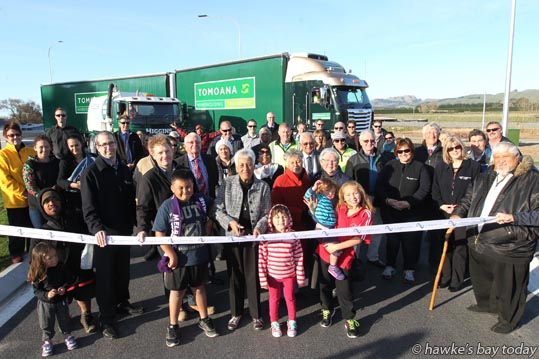 Centre: Waa Harris, local resident, cuts the ribbon, pictured with local residents and other interested parties - official opening of the new roundabout at Pakipaki, SH2, south of Hastings photograph
