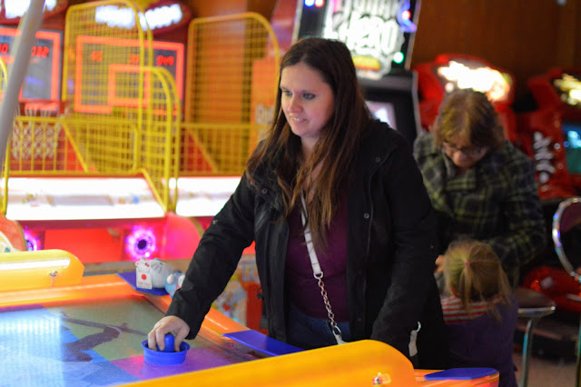 Lady Playing air hockey