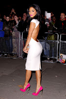 Nicole Scherzinger shows off her curves in a white dress