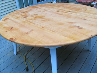 knotty pine table being refinished
