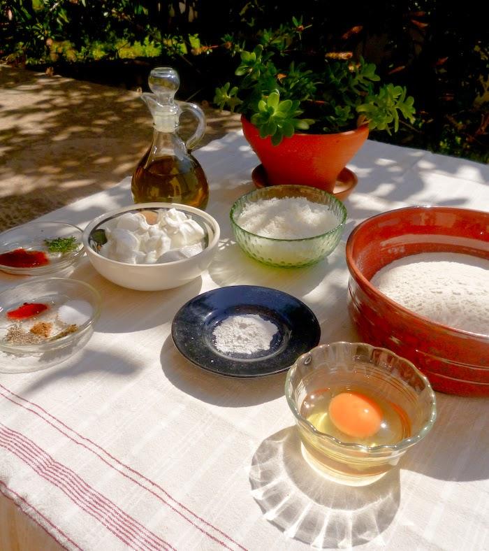 Ingredients photo: olive oil, ground cheese, flour, yogurt, egg, baking powder and spices