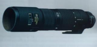 telephoto zoom lens merupakan jenis lensa kamera yang dapat membuat foto jauh menjadi dekat