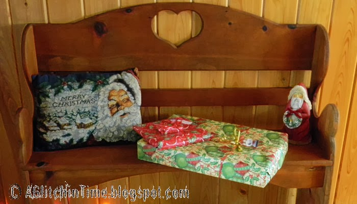 Prim bench with Christmas goodies.