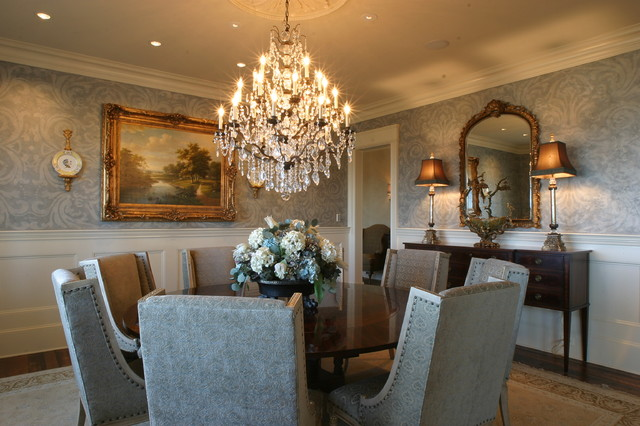 Gorgeous Crystal Chandelier in the Dining Room with Wooden Round Dining Tables and Grey Chairs around it