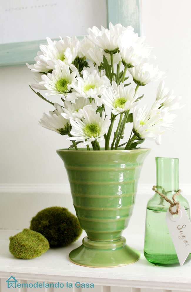 Green vase and bottle on Spring mantel