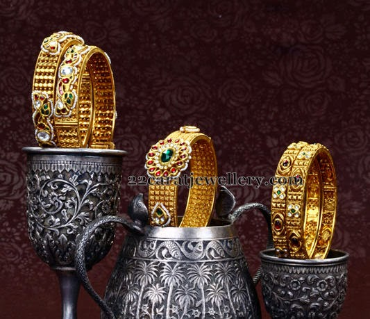 Broad Bangles With Emeralds
