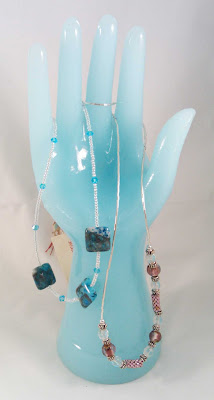 Hand display with necklaces