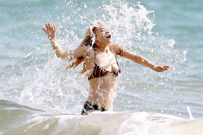 ASHLEY OLSEN splashing around in Hawaii
