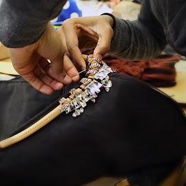 SAIC Swarovski Scholarship Award winning student sews Swarovski Crystals into her designs.
