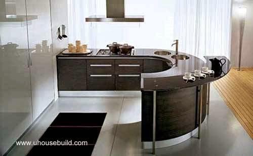 Cocina contemporánea color madera oscura con barra para desayunar curva