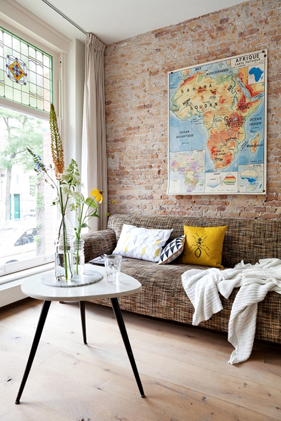 Safari Fusion blog | Love a good map | Vintage Africa map displayed on an exposed brick wall in a Netherlands home