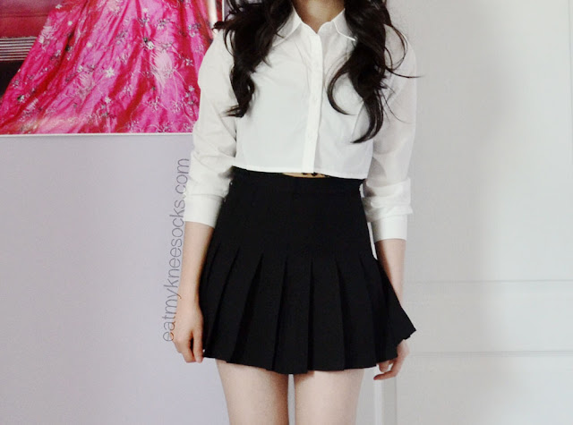 Simple black-and-white outfit featuring the cropped button-down shirt from SheInside and an American Apparel-dupe black pleated tennis skirt from SheInside.