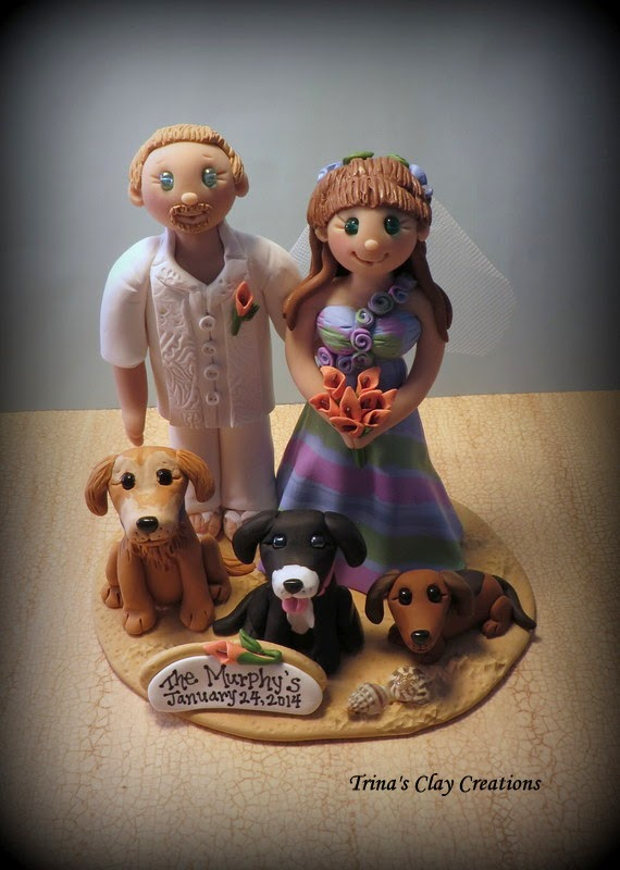 https://www.etsy.com/listing/180788371/wedding-cake-topper-custom-cake-topper