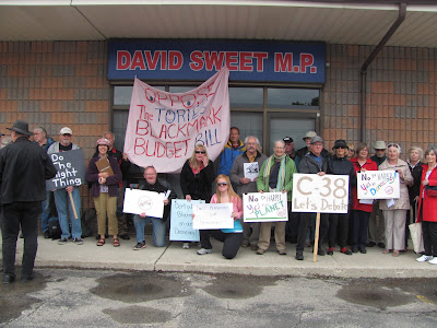 Protestors gather at MP David Sweet's office to oppose Omnibus Bill C-38 (Image Credit: Lorne Warwick)