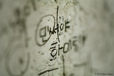 Small writings in Korean on a wall