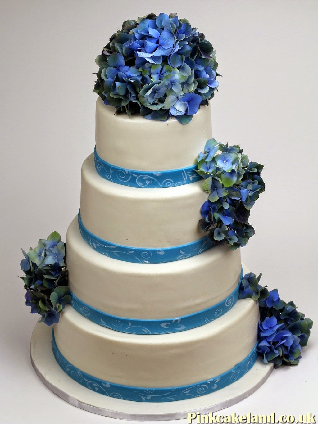 Wedding Cake with Blue Flowers.