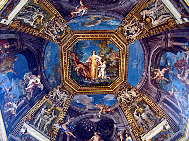 circular painting on the ceiling of the sistine chapel in rome