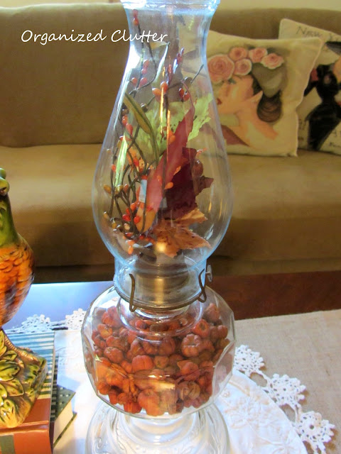 Putka Pods in the base of an oil lamp, Floral pick in chimney